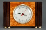 Stunning Art Deco Gilbert Rohde Clock with Brass Trim + Exotic Wood Veneer